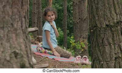 girl sitting in the forest and talking slow motion video