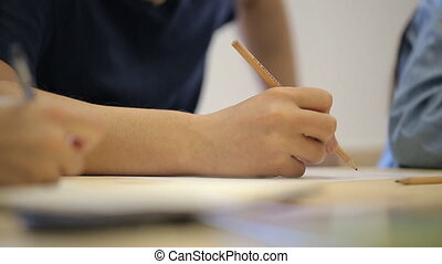 Close-up view of male drawing picture with pencil Man is...