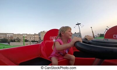 Girl is riding on an attraction