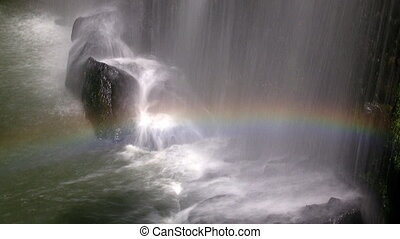 Beautiful waterfall with rainbow in Malaysia at slow speed