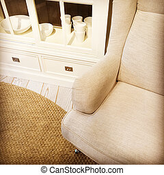 Detail of a living room with armchair and sideboard - Detail...