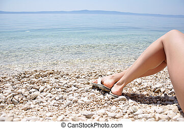 Woman legs on the beach
