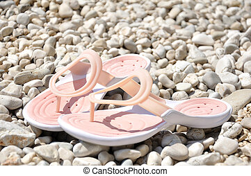 Pink slippers on the beach