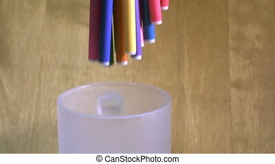 Felt-tip pens are rolled in a support, slow motion,