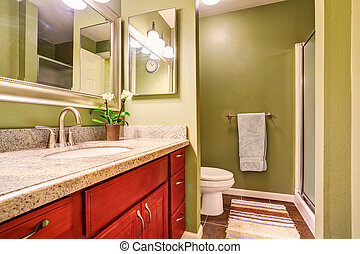 Nice bathroom interior with modern cabinet and green walls