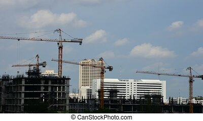 Daytime and crane with building con