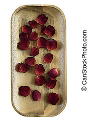 red rose petals on wooden tray - red rose petals on a wooden...