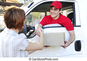 delivery courier delivering package and handshake - happy...