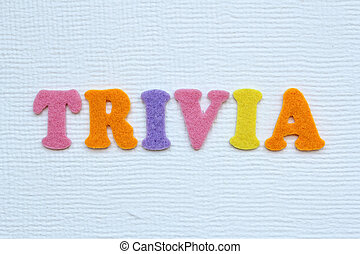 trivia concept - trivia word on white handmade paper texture