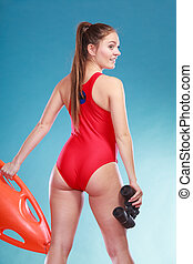 Lifeguard on duty with rescue buoy supervising - Lifeguard...
