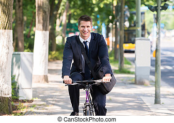 Male Businessman Riding Bicycle