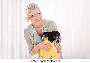 Woman Wiping Her Dog With Towel - Young Happy Woman Wiping...