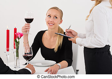 Waitress Taking An Order From A Couple
