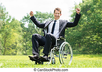 Disabled Man On Wheelchair With Raised Arms
