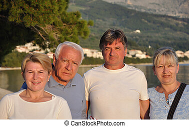 Old four people on the beach