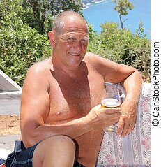 On vacation - An englishman relaxing in the sunshine with a...