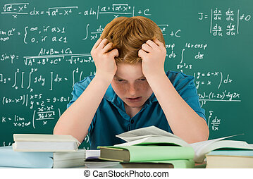 Frustrated Boy In Classroom