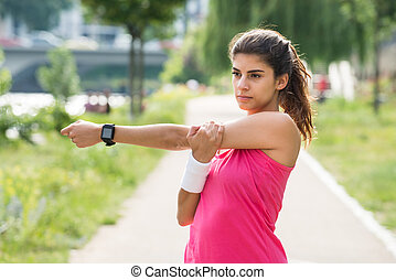 Woman Doing Fitness Exercise - Sporty Young Woman Stretching...