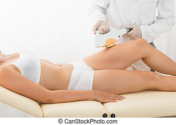 Young Woman Receiving Laser Epilation