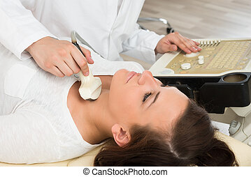 Woman Gets Ultrasound Of The Thyroid From Doctor - Young...