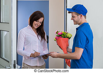 Woman Signing For Bouquet Delivery