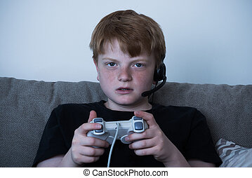 Boy With A Joystick Playing Videogames - Portrait Of Boy...