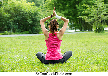 Woman Practicing Yoga - Rear View Of Young Woman Practicing...