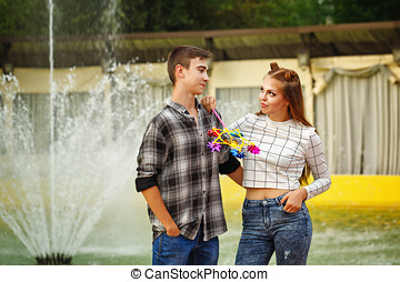 Enamoured teenagers Girlfriend and boyfriend strolling in a...
