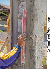 leveling concrete wall with tool Bubble spirit level water...
