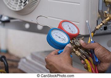 vacuum pump evacuates air from the air conditioner...