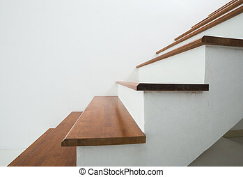wooden stairs in home - closed up of wooden stairs in home