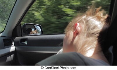 Wind Blowing Through Girl's Hair. Tired teenager girl...