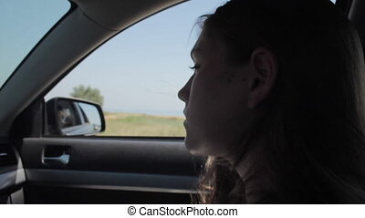 Wind Blowing Through Girl's silhouette and Hair In a car....