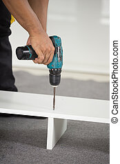 Assembling Furniture with a screwdriver - Assembling new...