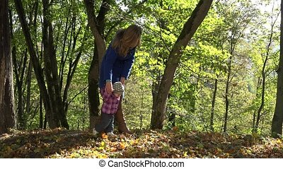 Woman teach baby child walking in autumn forest 4K - Woman...
