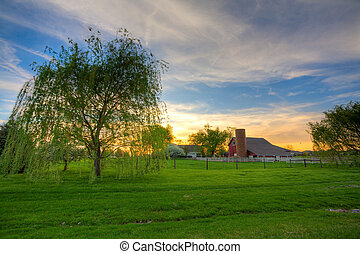 Sunset on the farm - Scenic view of a typical farm in...