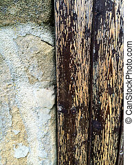 old abbey wall with door hinge