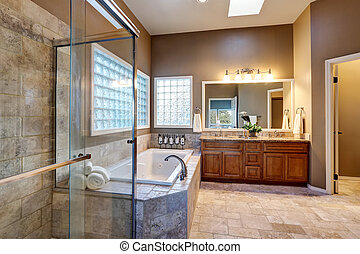 Luxury bathroom interior with vanity with granite counter...