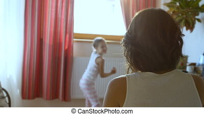 Happy mother having tender moments with her daughter while...