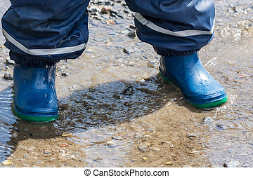Children legs in blue rubber boots - Child with blue rubber...