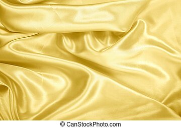 Gold fablic satin on background texture.