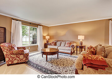 Traditional living room interior with beige walls, rug and white curtains