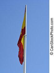 Spanish Flag against a blue sky - A Spanish flag against a...