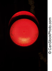 Red traffic light in dark