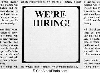 Job ad in newspaper - We're hiring headline on newspaper