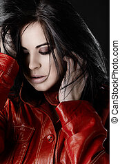 Beautiful woman with black hair in red leather jacket