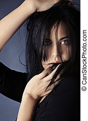 young woman touching her lips - Fashion photo of beautiful...