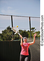 Young female playing tennis