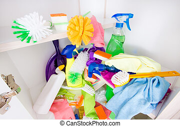 Messy cleaning supplies pantry - Top view of messy storage...