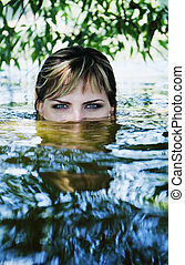 girl in a dark river water - Young beautiful girl in a dark...